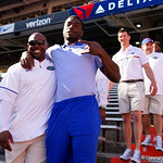 Florida Gators Assistant Coach, Running Backs Tim Skipper and Florida Gators running back Mark Thompson as the Gators walk into and across Steve Suprrier Field at  Ben Hill Griffin Stadium during Gator Walk as they prepare for the 2017 Orange and Blue Debut.  November 12th, 2016.  Gator Country photo by David Bowie.