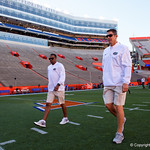 Florida Gators Offensive Coordinator/Quarterbacks Doug Nussmeier and Florida Gators Assistant Coach, Wide Receivers Kerry Dixon II as the Gators walk into and across Steve Suprrier Field at  Ben Hill Griffin Stadium during Gator Walk as they prepare for the 2017 Orange and Blue Debut.  November 12th, 2016.  Gator Country photo by David Bowie.