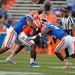Florida Gators tight end C'yontai Lewis is tacjkled by Florida Gators defensive back Joseph Putu as the Gators conclude their 2017 spring practices with the 2017 Orange and Blue Debut.  April 7th, 2017.  Gator Country photo by David Bowie.