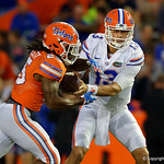 Florida Gators quarterback Feleipe Franks turns and hands the ball off to Florida Gators running back Jordan Scarlett as the Gators conclude their 2017 spring practices with the 2017 Orange and Blue Debut.  April 7th, 2017.  Gator Country photo by David Bowie.