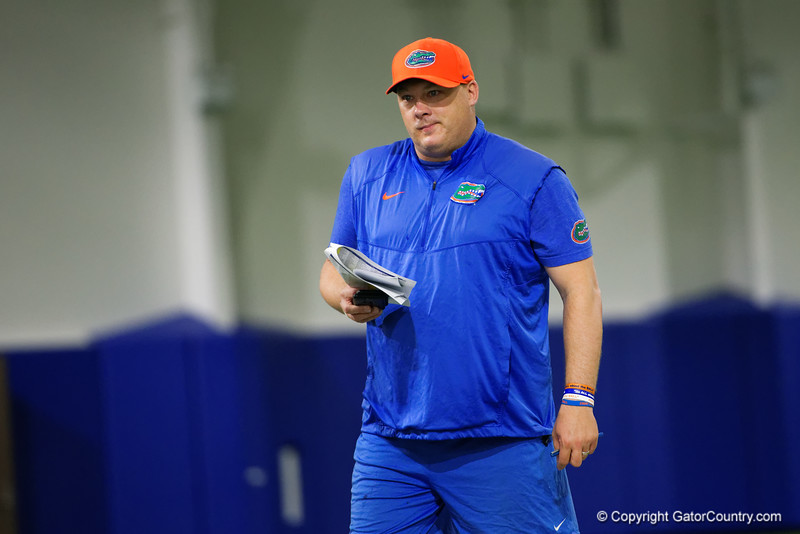 Florida Gators defensive coordinator Geoff Collins watches camp