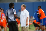 Florida Gators head coach Jim McElwain talks with Daytona Beach-Mainland defensive end Jachai Polite as High School football players from Florida and Georgia run drills and compete against each other as the University of Florida Gators get their summer camp circuit underway as they host a 7 on 7 tournament and a offensive line/defensive line camp on Friday night.  June 3rd, 2016. Gator Country photo by David Bowie.