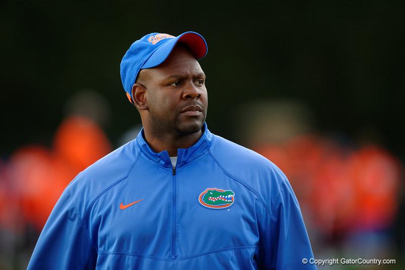 Florida Gators running backs coach Tim Skipper watches camp