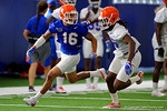 Florida Gators wide receiver Freddie Swain looks back to the quarterback and Florida Gators defensive back Marcell Harris stays with him in coverage, as the Gators run through practice drills finishing up their first week of fall practice.  August 5th, 2016.  Gator Country photo by David Bowie.