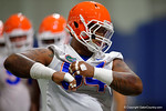 Florida Gators defensive lineman Khairi Clark adjusts his jersey as the Gators run through practice drills finishing up their first week of fall practice.  August 5th, 2016.  Gator Country photo by David Bowie.