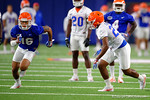 Florida Gators wide receiver Freddie Swain sprinting downfield being covered by Florida Gators defensive back Quincy Lenton as the Gators run through practice drills finishing up their first week of fall practice.  August 5th, 2016.  Gator Country photo by David Bowie.