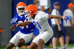 Florida Gators wide receiver Antonio Callaway sprinting downfield as Florida Gators defensive back McArthur Burnett does his best to stay with him, as the Gators run through practice drills finishing up their first week of fall practice.  August 5th, 2016.  Gator Country photo by David Bowie.