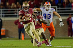 Florida State quarterback Deondre Francois scrambling downfield for a first down during the first half as the Gators go into Doak Campbell Stadium and lose to the Florida State Seminoles 31-13.  November 26th, 2016.  Gator Country photo by David Bowie.