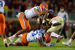 Florida Gators defensive backs Quincy Wilson and Chauncey Gardner combine for a tackle on FSU running back Dalvin Cook as the Gators go into Doak Campbell Stadium and lose to the Florida State Seminoles 31-13.  November 26th, 2016.  Gator Country photo by David Bowie.
