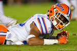 Florida Gators defensive back Jeawon Taylor lays on the ground in pain after being injured as the Gators go into Doak Campbell Stadium and lose to the Florida State Seminoles 31-13.  November 26th, 2016.  Gator Country photo by David Bowie.