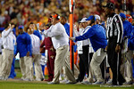Florida Gators Defensive Coordinator Geoff Collins being held back while coaching up his defense as the Gators go into Doak Campbell Stadium and lose to the Florida State Seminoles 31-13.  November 26th, 2016.  Gator Country photo by David Bowie.