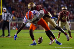 Florida Gators tight end C'yontai Lewis is wrapped up while trying to make a catch, as the Gators go into Doak Campbell Stadium and lose to the Florida State Seminoles 31-13.  November 26th, 2016.  Gator Country photo by David Bowie.