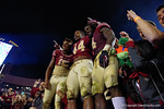 Florida State defensive end DeMarcus Walker,quarterback Deondre Francois and running back Dalvin Cook celebrate with the fans as the Gators go into Doak Campbell Stadium and lose to the Florida State Seminoles 31-13.  November 26th, 2016.  Gator Country photo by David Bowie.