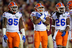 Florida Gators defensive lineman Keivonnis Davis, Florida Gators linebacker David Reese and Florida Gators defensive back Marcell Harris look to the sidelines for the play call as the Gators go into Doak Campbell Stadium and lose to the Florida State Seminoles 31-13.  November 26th, 2016.  Gator Country photo by David Bowie.