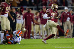 Florida State DB Marquez White celebrates after a hit on Florida Gators wide receiver Brandon Powell as the Gators go into Doak Campbell Stadium and lose to the Florida State Seminoles 31-13.  November 26th, 2016.  Gator Country photo by David Bowie.