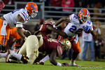 Florida Gators running back Lamical Perine being tackled as the Gators go into Doak Campbell Stadium and lose to the Florida State Seminoles 31-13.  November 26th, 2016.  Gator Country photo by David Bowie.