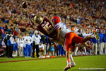 Florida Gators defensive back Teez Tabor breaks up the reception effort by Florida State wide receiver Travis Rudolph as the Gators go into Doak Campbell Stadium and lose to the Florida State Seminoles 31-13.  November 26th, 2016.  Gator Country photo by David Bowie.