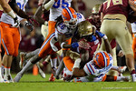 Florida Gators defensive back Marcell Harris makes a big hit on Seminoles running back Dalvin Cook as the Gators go into Doak Campbell Stadium and lose to the Florida State Seminoles 31-13.  November 26th, 2016.  Gator Country photo by David Bowie.