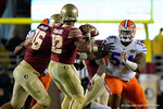 Florida Gators defensive lineman Khairi Clark rushing the quarterback as the Gators go into Doak Campbell Stadium and lose to the Florida State Seminoles 31-13.  November 26th, 2016.  Gator Country photo by David Bowie.