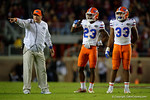 Florida Gators Defensive Coordinator Geoff Collins coaching up Florida Gators defensive back Chauncey Gardner and Florida Gators linebacker David Reese as the Gators go into Doak Campbell Stadium and lose to the Florida State Seminoles 31-13.  November 26th, 2016.  Gator Country photo by David Bowie.