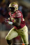 Florida State fullback Freddie Stevenson gets the ball and rushes into the endzone for a FSU touchdown, as the Gators go into Doak Campbell Stadium and lose to the Florida State Seminoles 31-13.  November 26th, 2016.  Gator Country photo by David Bowie.