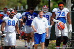 Florida Gators head coach Jim McElwain and offensive linemen Fred Johnson and Richerd Desir-Jones walk to the indoor practice facility on Wednesday for another spring practice as the Gators prepare for their annual Orange and Blue Game.  March 30th, 2016.  Gator Country photo by David Bowie.