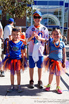 A Florida Gators family pose at the Fan Zone propr to the University of Florida's annual spring gme, the Orange and Blue debut called Swamp Night this year.  April 8th, 2016.  Gator Country Photo by David Bowie.