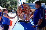 A Florida Gators fan spins a wheel from Dominos Pizza to win free food at the Fan Zone propr to the University of Florida's annual spring gme, the Orange and Blue debut called Swamp Night this year.  April 8th, 2016.  Gator Country Photo by David Bowie.