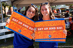 Two University of Florida Gator fans pose at the Fan Zone propr to the University of Florida's annual spring gme, the Orange and Blue debut called Swamp Night this year.  April 8th, 2016.  Gator Country Photo by David Bowie.