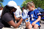 Florida Gators fans get their face and arm painted at the Fan Zone propr to the University of Florida's annual spring gme, the Orange and Blue debut called Swamp Night this year.  April 8th, 2016.  Gator Country Photo by David Bowie.