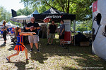 Florida Gators fans throw footballs at the Verizon tent at the Fan Zone propr to the University of Florida's annual spring gme, the Orange and Blue debut called Swamp Night this year.  April 8th, 2016.  Gator Country Photo by David Bowie.