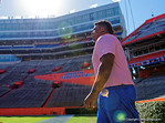 The University of Florida Gators football team walks into the Ben Hill Griffin Stadium during Gator Walk for their Orange and Blue debut called Swamp Night this year.  April 8th, 2016.  Gator Country Photo by David Bowie.