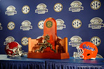 The SEC Championship trophy, the Florida Gators and Alabama Crimson Tide helmet during media day for the 2016 SEC Championship at the Georgia Dome in Atlanta, Georgia.  December 2nd, 2016.  Gator Country photo by David Bowie.
