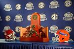 The SEC Championship trophy, the Florida Gators and Alabama Crimson Tide helmet during media day for the 2016 SEC Championship at the Georgia Dome in Atlanta, Georgia.  December 2nd, 2016.  Gator Country photo by David Bowie.