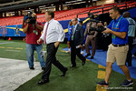 Florida Gators Head Coach Jim McElwain walks onto the field during media day for the 2016 SEC Championship at the Georgia Dome in Atlanta, Georgia.  December 2nd, 2016.  Gator Country photo by David Bowie.