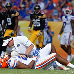 A Florida Gators trainer checks on Florida Gators linebacker Kylan Johnson during the first half as the Florida Gators defeat the University of Iowa Hawkeyes 30-3 in the 2017 Outback Bowl in Tampa, Florida.  January 2nd, 2017.  Country photo by David Bowie.