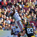 Florida Gators linebacker Daniel McMillian leaps into the air for an interception and then turns upfield during the second half as the Florida Gators defeat the University of Iowa Hawkeyes 30-3 in the 2017 Outback Bowl in Tampa, Florida.  January 2nd, 2017.  Country photo by David Bowie.