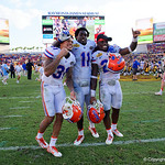 Florida Gators defensive back Teez Tabor,Florida Gators linebacker Vosean Joseph and Florida Gators defensive back Chauncey Gardner as the Florida Gators celebrate defeating the University of Iowa Hawkeyes 30-3 in the 2017 Outback Bowl in Tampa, Florida.  January 2nd, 2017.  Country photo by David Bowie.