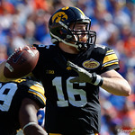 Iowa Hawkeyes quarterback C.J. Beathard throwing during the first half as the Florida Gators defeat the University of Iowa Hawkeyes 30-3 in the 2017 Outback Bowl in Tampa, Florida.  January 2nd, 2017.  Country photo by David Bowie.