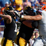 Florida Gators defensive lineman Taven Bryan gets a hand to the face of Iowa quarterback CJ Beathard during the second half as the Florida Gators defeat the University of Iowa Hawkeyes 30-3 in the 2017 Outback Bowl in Tampa, Florida.  January 2nd, 2017.  Country photo by David Bowie.