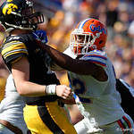 Florida Gators defensive lineman Jabari Zuniga puts a hit on Iowa Hawkeyes quarterback CJ Beathard during the first half as the Florida Gators defeat the University of Iowa Hawkeyes 30-3 in the 2017 Outback Bowl in Tampa, Florida.  January 2nd, 2017.  Country photo by David Bowie.