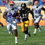 Florida Gators running back Mark Thompson takes a swing pass to the house to put the Gators up 10-3 during the first half as the Florida Gators defeat the University of Iowa Hawkeyes 30-3 in the 2017 Outback Bowl in Tampa, Florida.  January 2nd, 2017.  Country photo by David Bowie.