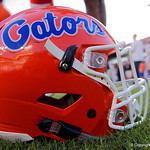 A Florida Gators helmet sits on the field as the Florida Gators celebrate defeating the University of Iowa Hawkeyes 30-3 in the 2017 Outback Bowl in Tampa, Florida.  January 2nd, 2017.  Country photo by David Bowie.