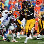 Florida Gators defensive back Marcell Harris makes a tackle on Iowa running back LeShun Daniels Jr.during the second half as the Florida Gators defeat the University of Iowa Hawkeyes 30-3 in the 2017 Outback Bowl in Tampa, Florida.  January 2nd, 2017.  Country photo by David Bowie.