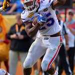 Florida Gators running back Jordan Scarlett rushing during the first half as the Florida Gators defeat the University of Iowa Hawkeyes 30-3 in the 2017 Outback Bowl in Tampa, Florida.  January 2nd, 2017.  Country photo by David Bowie.