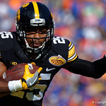 Iowa Hawkeyes running back Akrum Wadley rushing during the first half as the Florida Gators defeat the University of Iowa Hawkeyes 30-3 in the 2017 Outback Bowl in Tampa, Florida.  January 2nd, 2017.  Country photo by David Bowie.