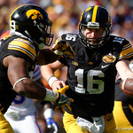Iowa Hawkeyes quarterback C.J. Beathard turns to hand the ball off during the first half as the Florida Gators defeat the University of Iowa Hawkeyes 30-3 in the 2017 Outback Bowl in Tampa, Florida.  January 2nd, 2017.  Country photo by David Bowie.