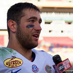 Florida Gators quarterback Austin Appleby giving a post game interview as the Florida Gators celebrate defeating the University of Iowa Hawkeyes 30-3 in the 2017 Outback Bowl in Tampa, Florida.  January 2nd, 2017.  Country photo by David Bowie.