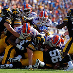 Florida Gators running back Jordan Scarlett fights for a first down during the first half as the Florida Gators defeat the University of Iowa Hawkeyes 30-3 in the 2017 Outback Bowl in Tampa, Florida.  January 2nd, 2017.  Country photo by David Bowie.
