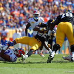 Florida Gators linebacker Daniel McMillian makes a tackle during the first half as the Florida Gators defeat the University of Iowa Hawkeyes 30-3 in the 2017 Outback Bowl in Tampa, Florida.  January 2nd, 2017.  Country photo by David Bowie.